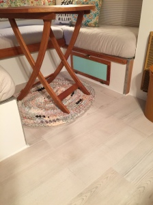 Beautiful new vinyl plank flooring with the look of weathered beach wood